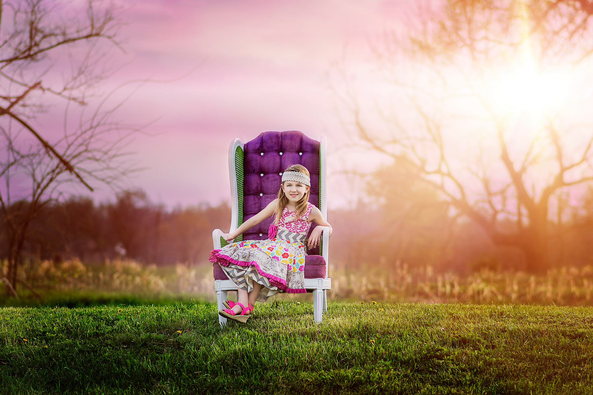 Young girl sitting in purple chair wearing mustard pie