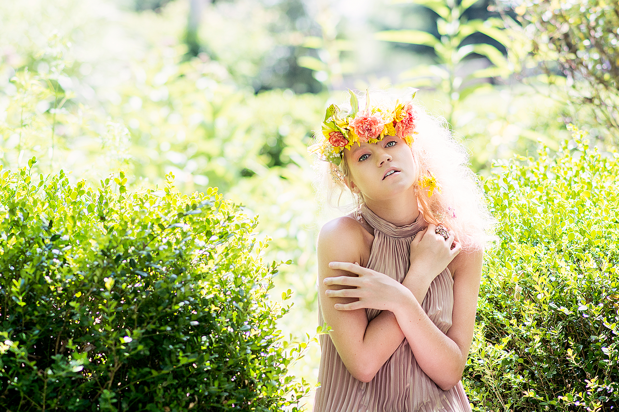Girl backlit wearing flower crown by Louisville Fashion Photographer