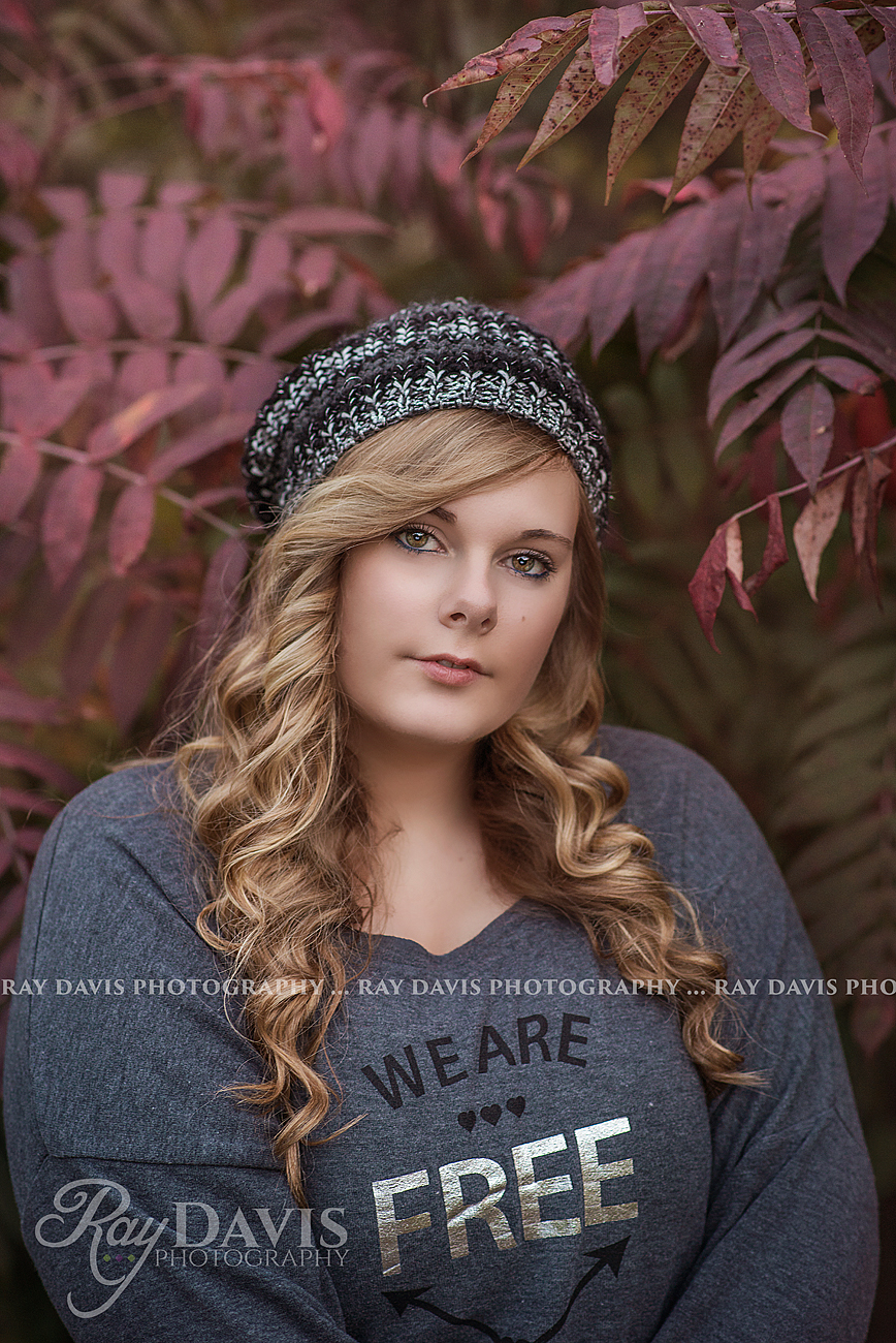 Plus Size High School Senior Picture of girl with long curly hair by Louisville Senior Photographer Ray Davis