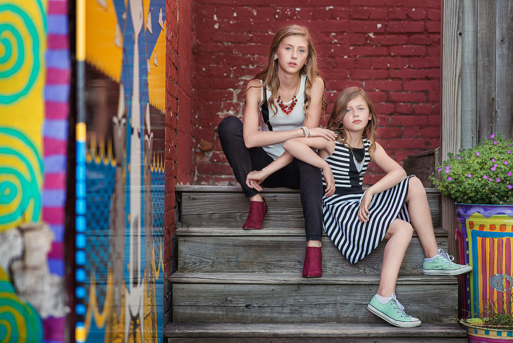 Lexington tween sisters pose on stairs