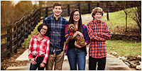 Family pictures of kids and dog in the fall by Louisville Family Portrait Photographer