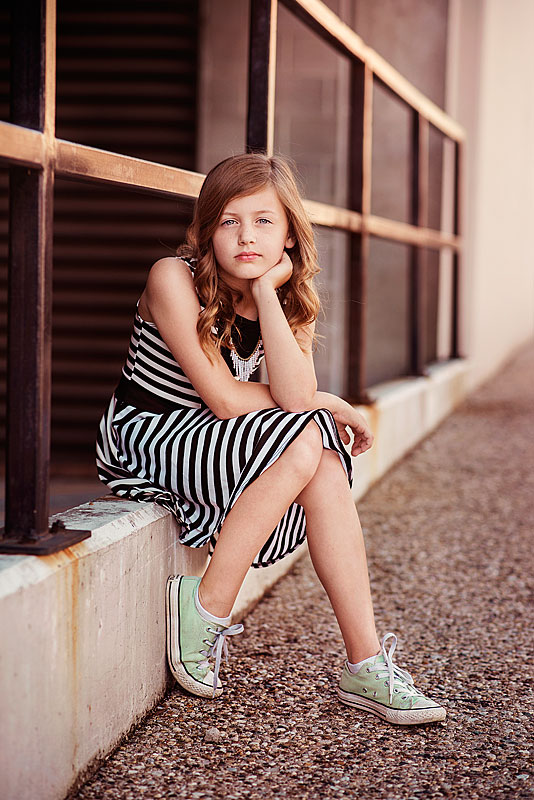 Tween wearing striped dress in downtown louisville