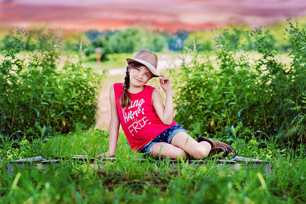 Versailles child wearing hat in country field