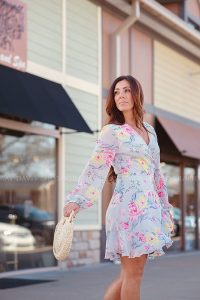 Woman walking through Westport Village in clothes from Darling State of Mind Boutique taken by Louisville Business Branding Photographer