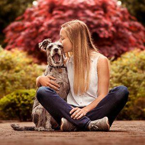 Louisville Senior Session of girl kissing her pet dog