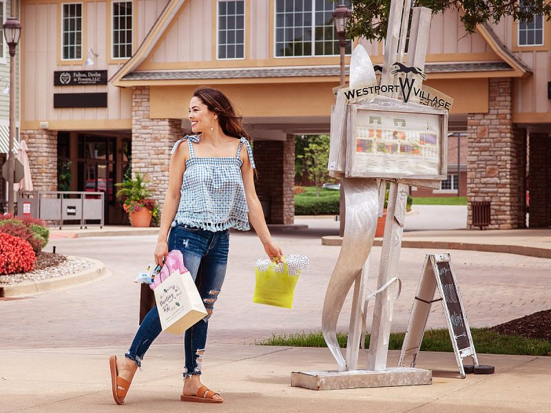 Westport Village Shopping Center with Girl with bags by Branding Photographer