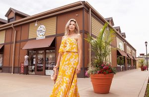 Shopping in yellow dress of Darling State of Mind in Westport Village by Louisville Instagram Photographer