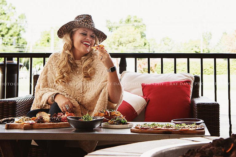 Woman enjoying tapas at Artesano now Steak and Bourbon restaurant in Westport VIllage