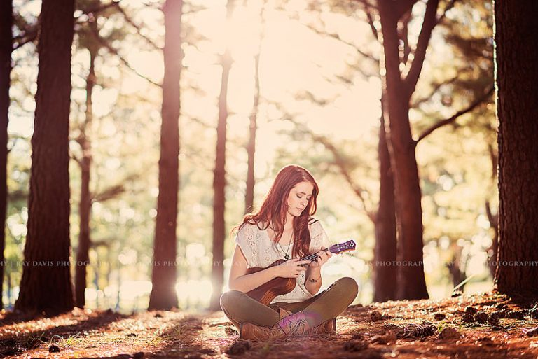 Red Head Girl playing ukulele in woods for Louisville Senior Pictures Ray Davis