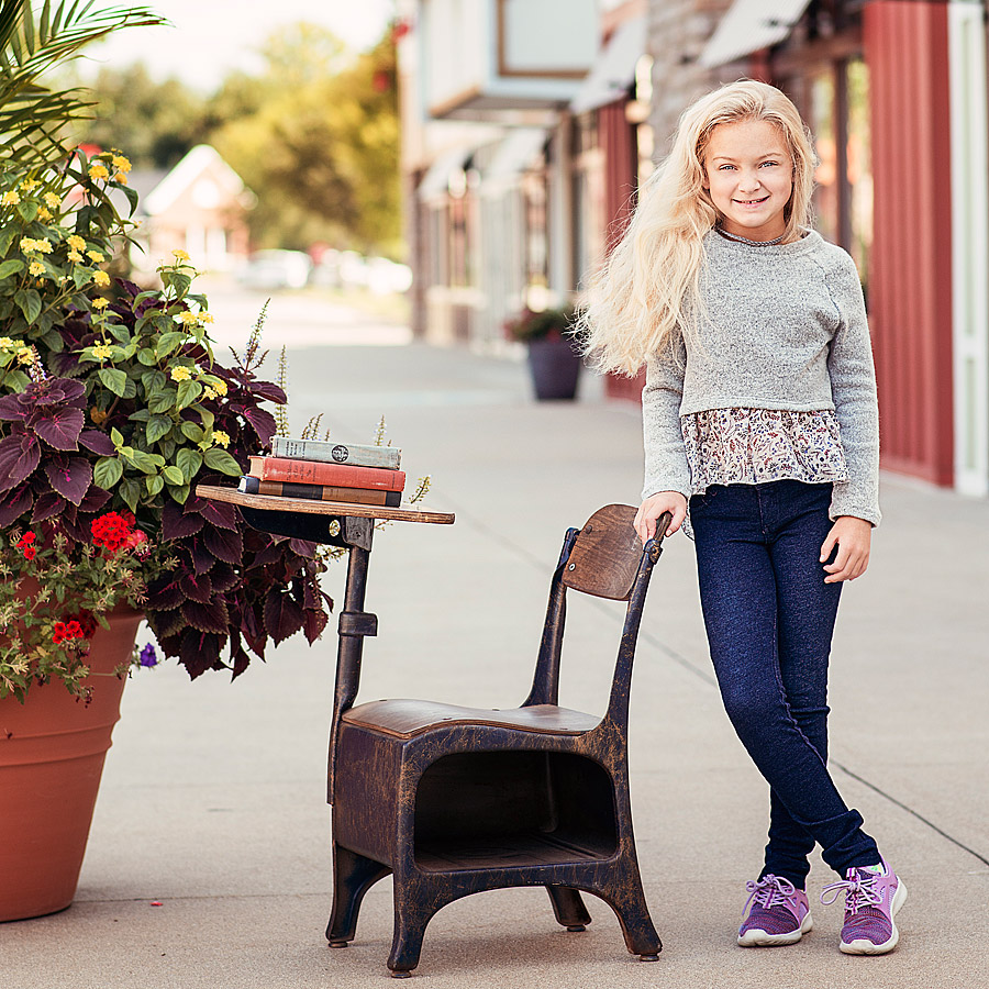 Tween girl standing by desk during Louisville Tween Photographers Back to School Mini Session Event