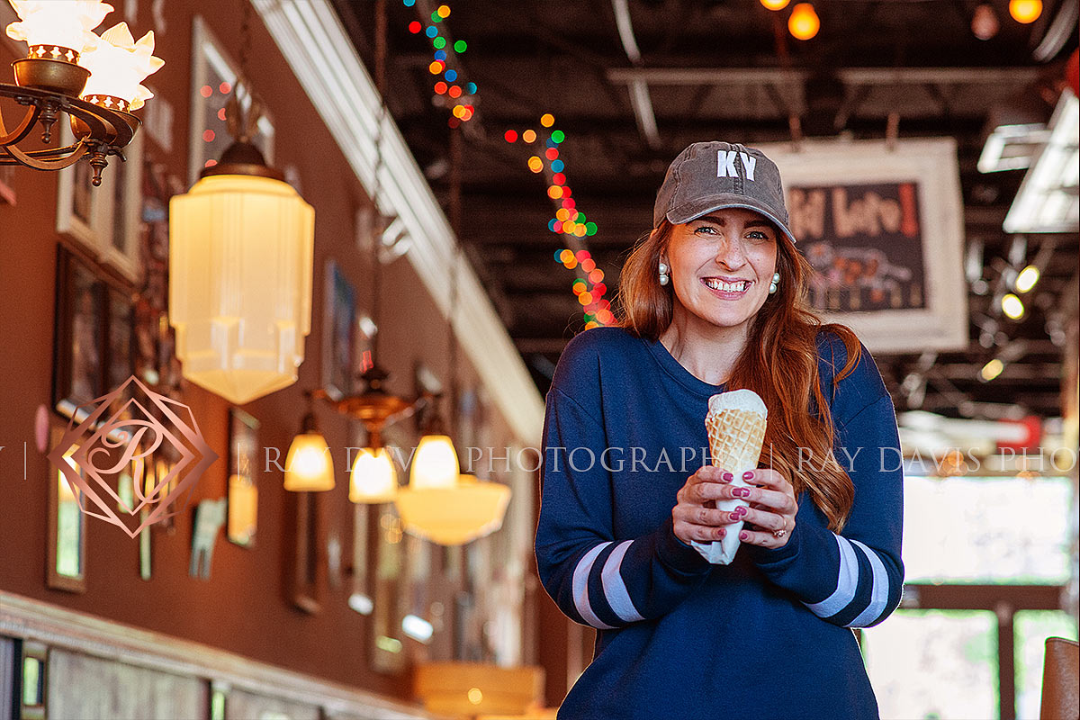 Woman holding icecream at the Comfy Cow during Louisville Branding photosession with Ray Davis Photography