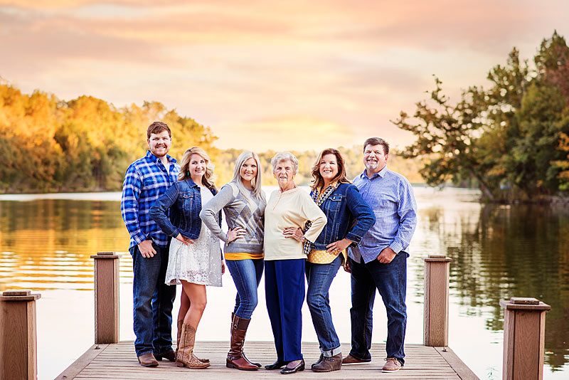 Louisville Family Photographer portrait of family on lake wearing blue and yellow