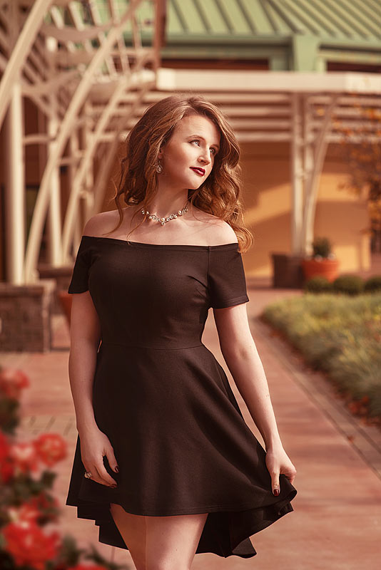 Celebrating 30 in style woman in black dress by Empowered Women Photographer