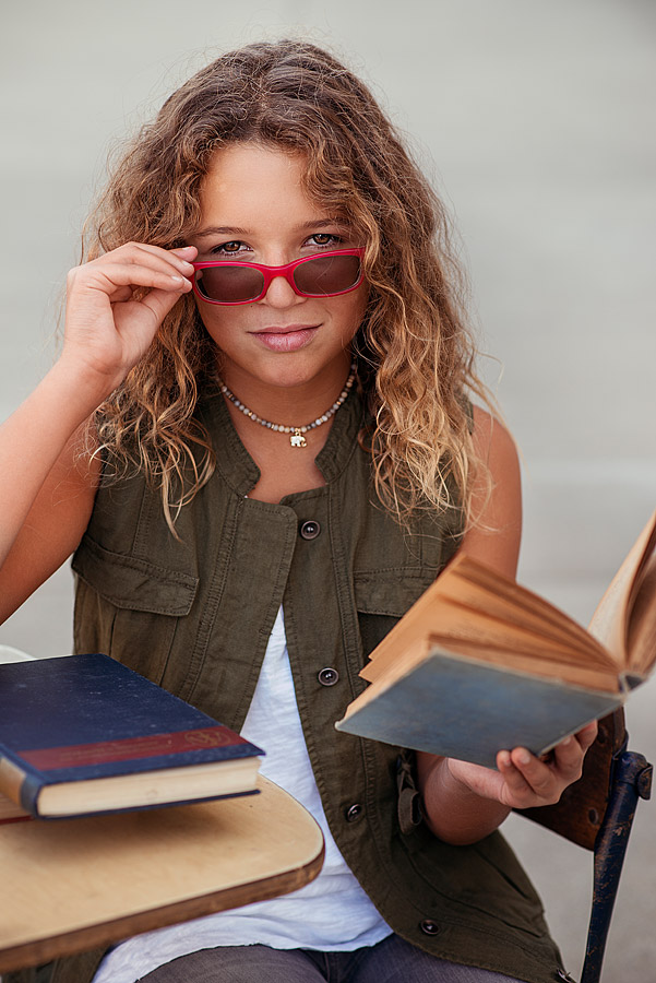Tween Girl with Textbook holding glasses from Louisville Photographers Back To School Mini Session