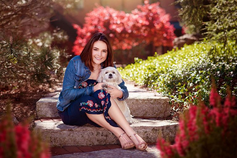 Girl sitting on steps with dog for spring senior pictures by Ray Davis Photography