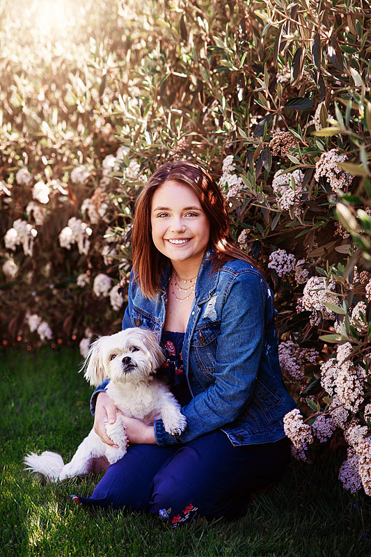 Louisbille Senior Pictures with maltese dog in front of flowering bush