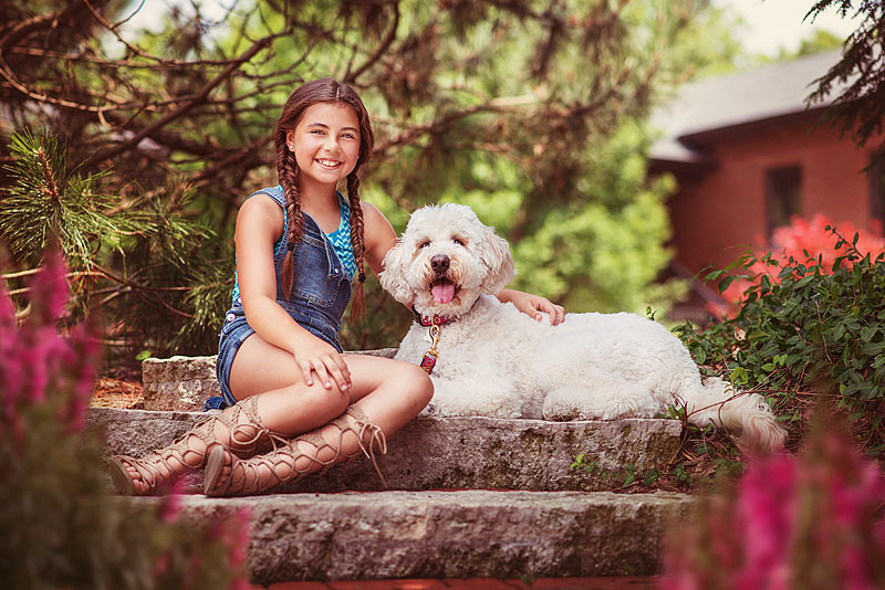 Louisville Tween girl sitting with large poodle dog in Easter Spring Pictures by Louisville Child Photographer