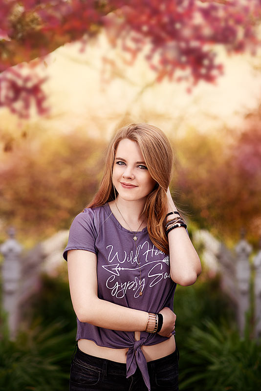 Oldham COunty Highschool Senior Picture of girl in purple crop top by Louisville Senior Photographer Ray Davis