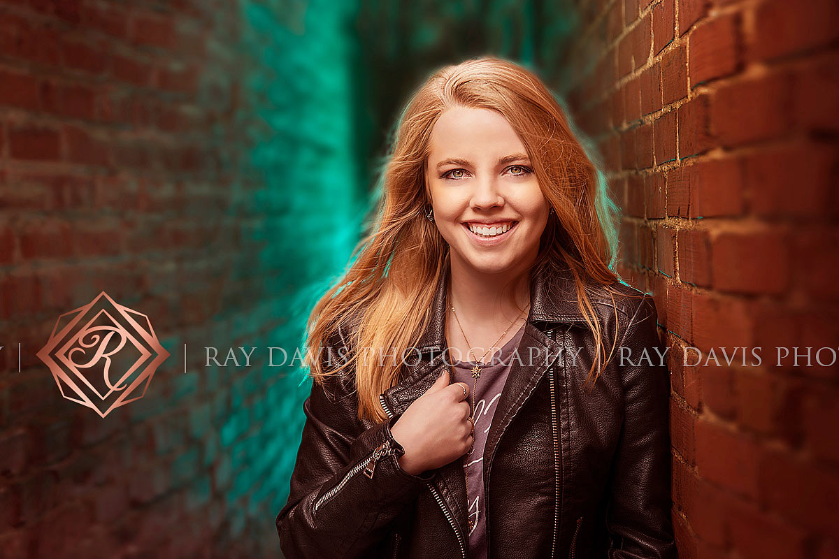 Blonde senior girl in alley way with off camera flash in urban lagrange taken by louisville photographer Ray Davis Photography