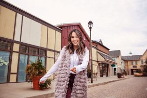 Girl walking through Westport Village in Tunies Boutique Fall Outfit for Social Media Content