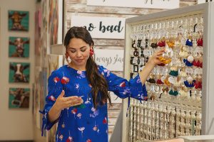 Girl Shopping Earrings at Tunies Boutique in Westport Village by Louisville Content Photographer