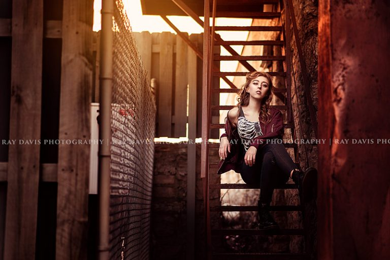 Urban Street style girl sitting on metal stair in downtown for Louisville Senior Pictures with Ray Davis Photography