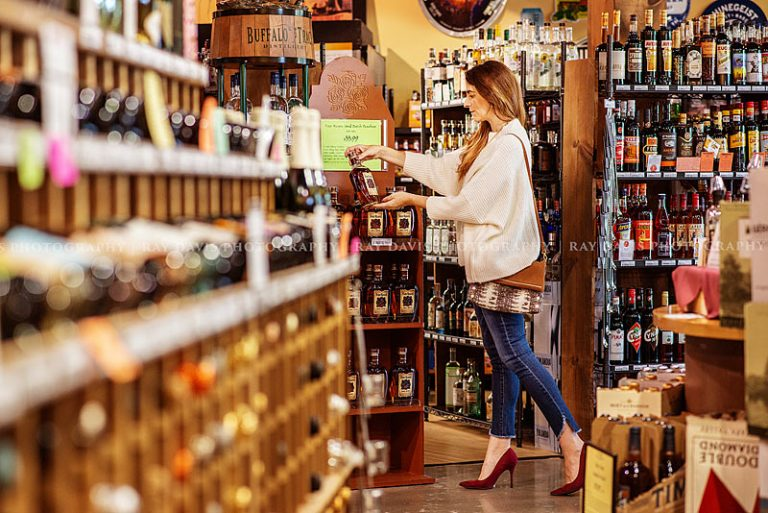 Woman shopping at Westport Whiskey & Wine for Four Roses Bourbon