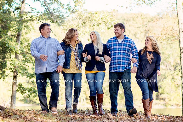 older family walking by lake arm in arm by Louisville family photographer