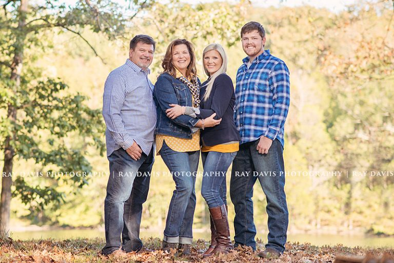 Mature family portrait on edge of lake by Louisville Photographer