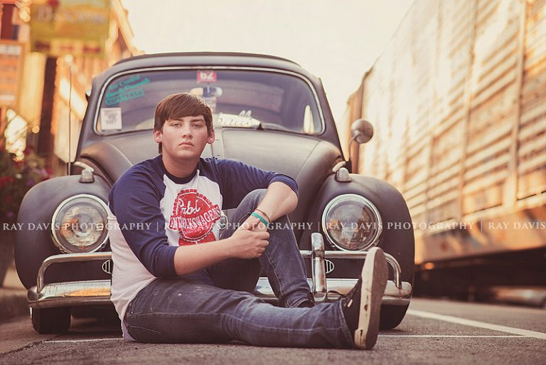 oldham county high school senior in from of VW beetle taken by Ray Davis Photography