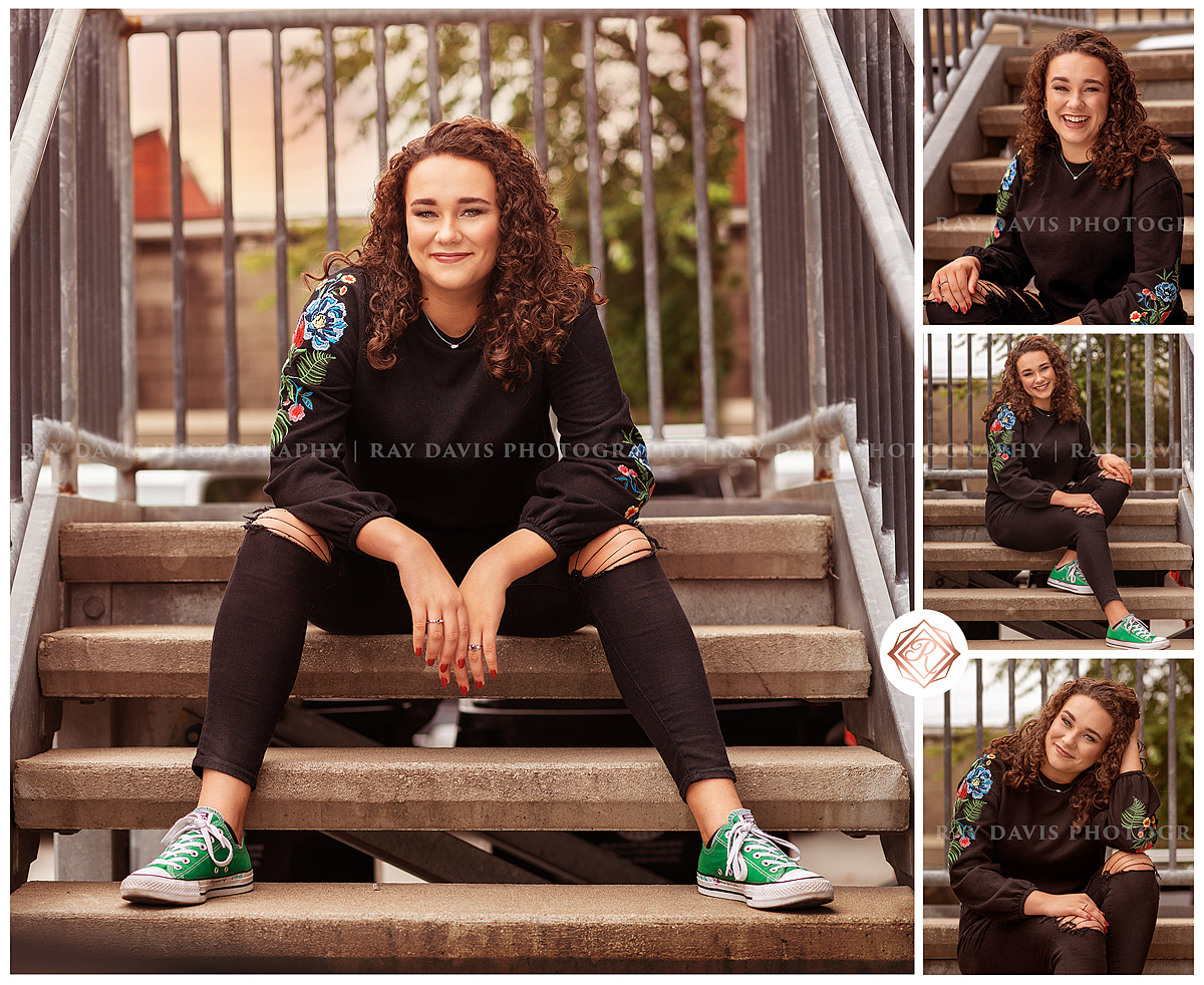 Curly Haired girl sitting on steps in downtown Louisville for Senior Pictures