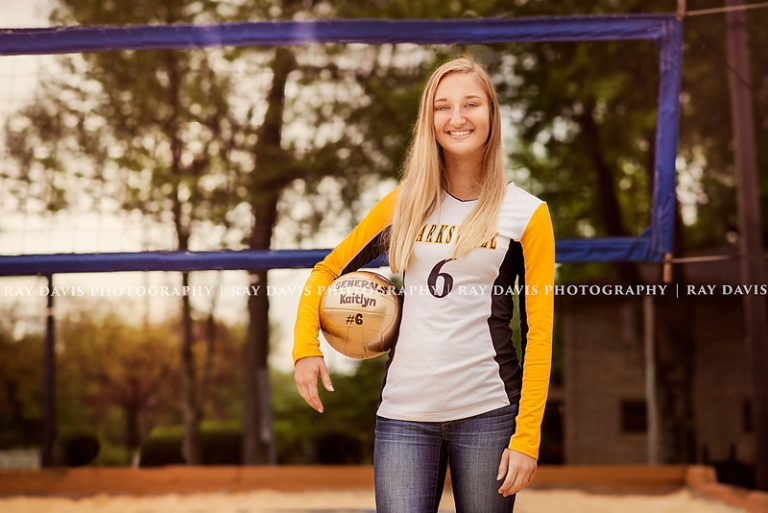 Senior girl picture in front of Volleyball Net