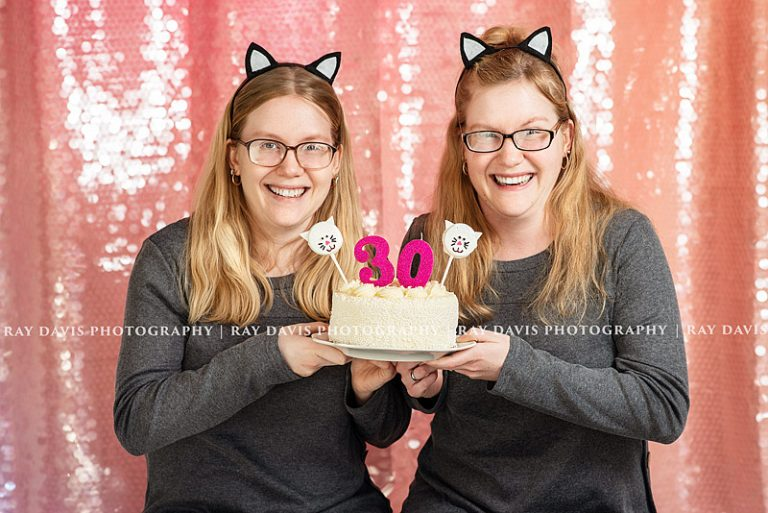 Twin 30th Bday Girls holding Cat Cake