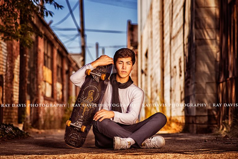 urban-senior-boy-skateboard-pose-downtown-louisville-ky