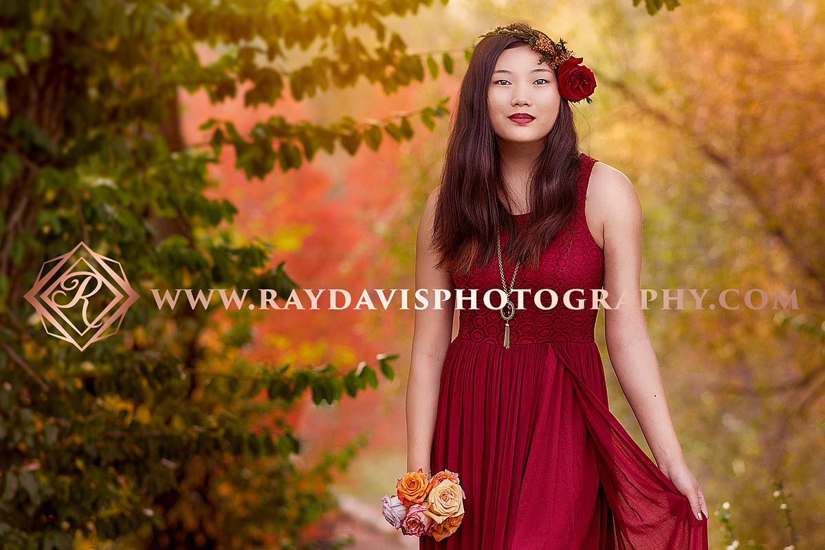 Girl in red dress and flower crown for Senior boho portraits in Louisville KY