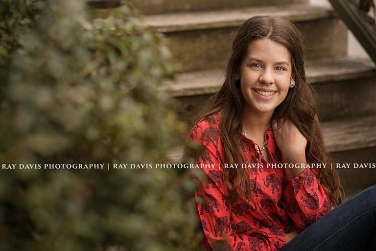 Teen girl sitting on steps in Anchorage KY by Louisville Family Photographer